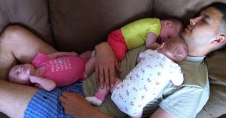 triplets-sleeping-on-dad-e1339528811296